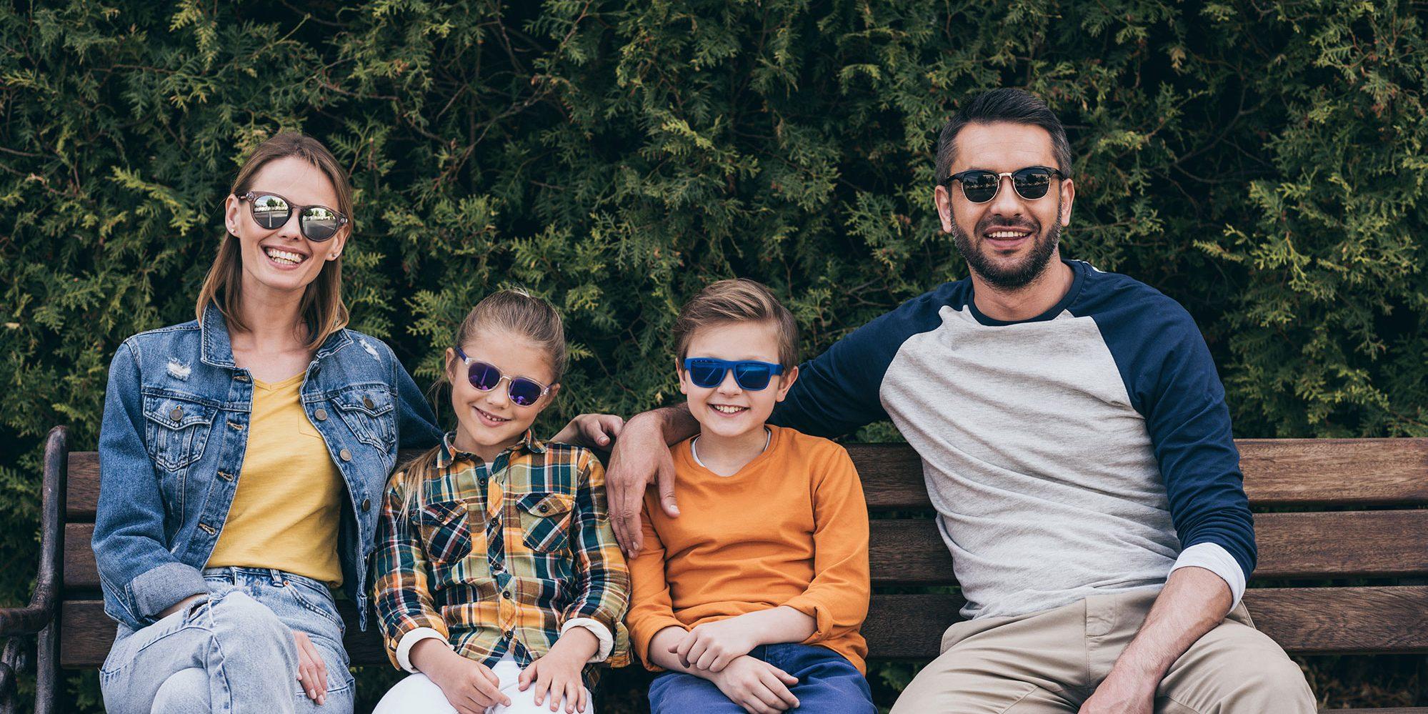 A family outside wearing sunglasses